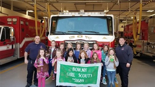 Fire Fighters pose with Bow Girlscout Troop