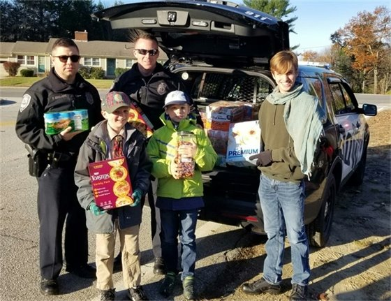 Bow Police Association donating a cruiser full of food.