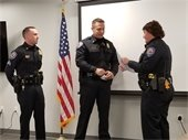 Chief Lougee presenting the Life Saving Ribbon and Certificate to Sergeant Lamy and K-9 Officer Matt Pratte