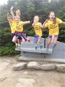Girls jumping off Rock